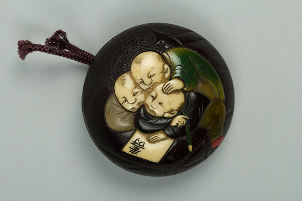 Netsuke, Wood inlaid with ivory, Japan