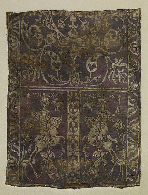"Fragment of a Band with Noble Equestrian and Soldier, Inscribed ""Zacharaiou"" in Greek, Weft-faced compound twill ( samit ) in reddish purple and beige silk"