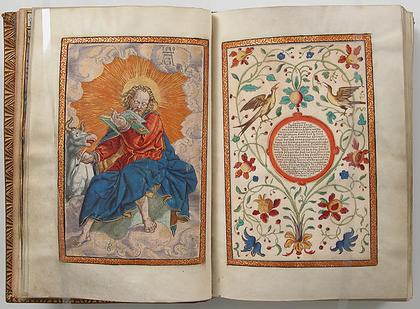 Illuminated manuscript with two pages. On the left is a man holding a book in one hand and the reins of an oxe on the other. There are flowers and birds on the right page which surround a circle with text on the inside.