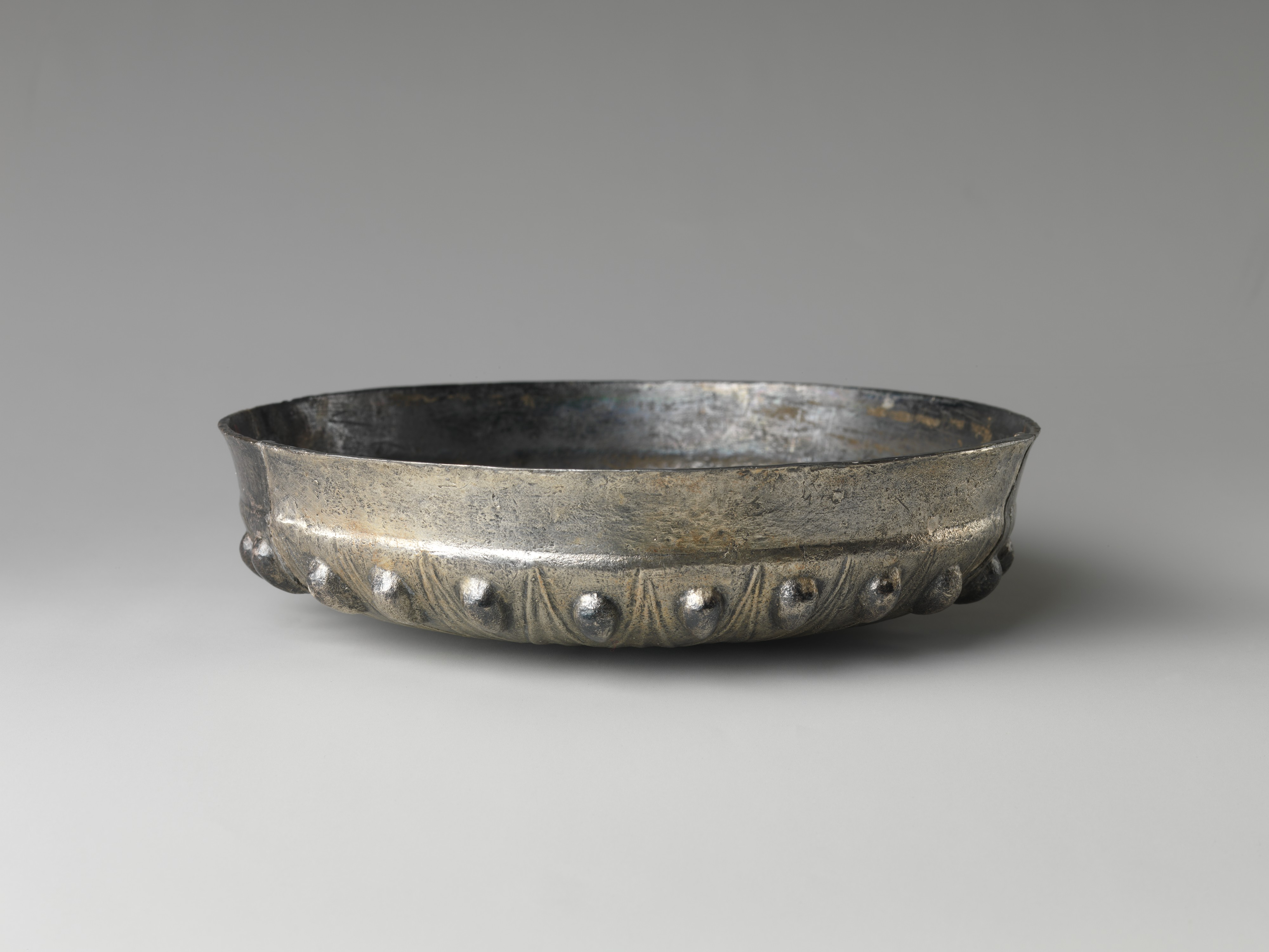 Bowl with bosses and lotus pattern and demotic weight on rim | Late