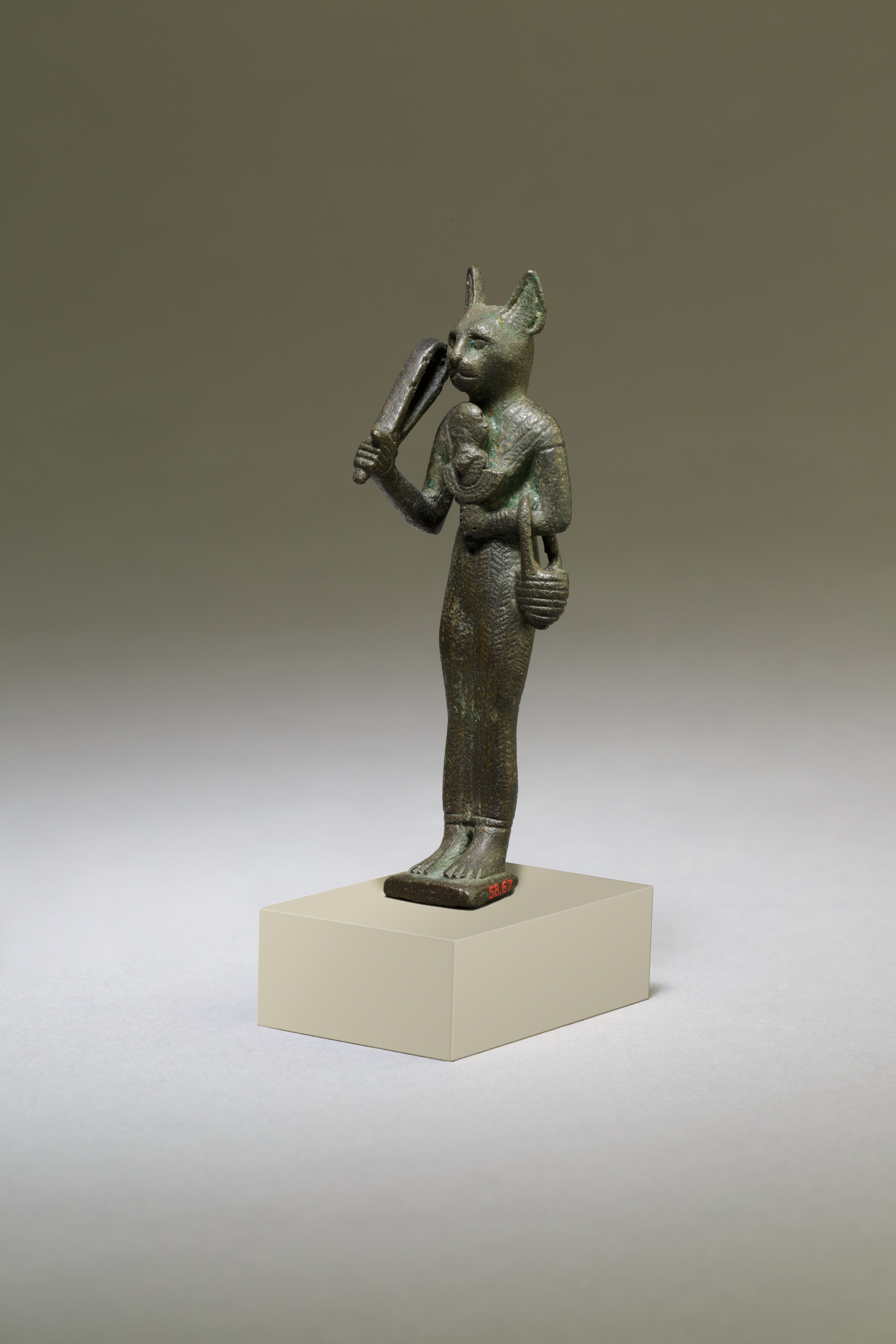 Curpreous metal figure of the Egyptian cat goddess Bastet.