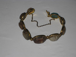 Nine scarabs set in modern bracelet., Glazed steatite, gold