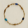 Bracelet with wedjat eye amulets and barrel beads, Linen, gold, glass, faience
