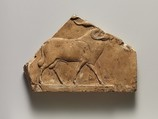 Relief plaque with ram, and on opposite side two feet, Limestone