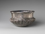 Bowl with acorn bosses at shoulder, lotus pattern beneath, and rosette on bottom, and with inscribed weight, Silver