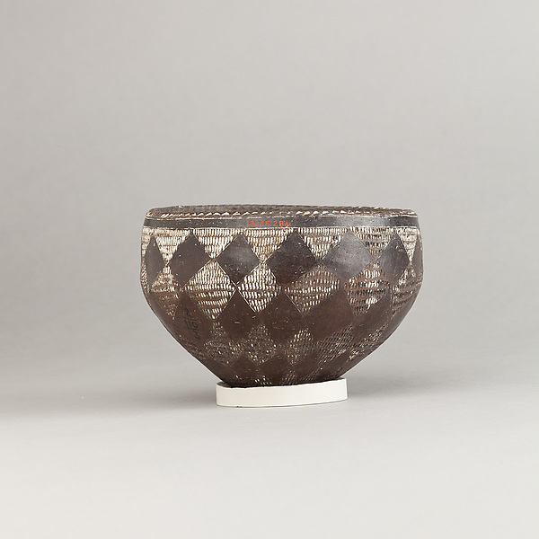 Drinking Cup, Black incised ware with white filling.