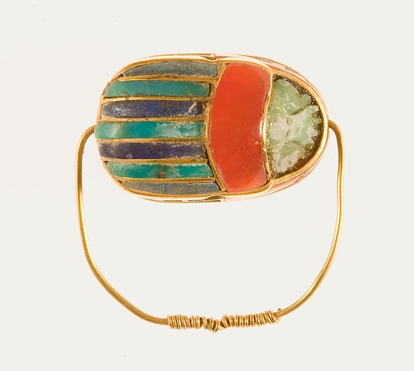 Scarab ring of Sithathoryunet, Gold, carnelian, lapis lazuli, and turquoise, bedding material
