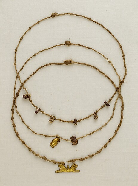 Necklace with 6 Taweret amulets, Linen, breccia