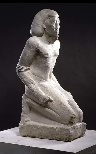 Kneeling captive, Limestone, paint