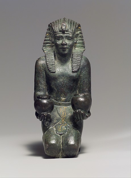 Kneeling statuette of King Amasis, Bronze, precious metal inlay and leaf