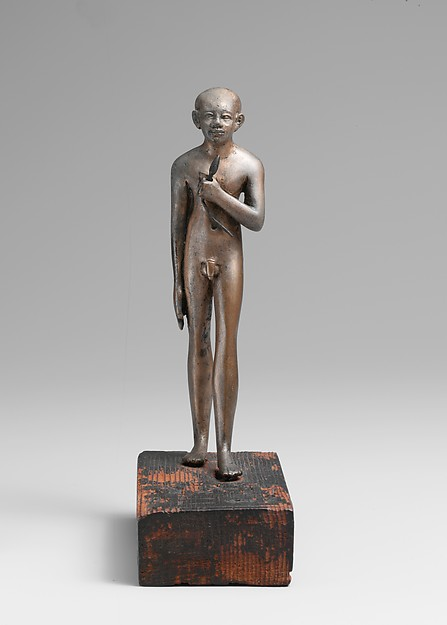 Statuette of the Child Amenemhab, Bronze, separate silver lotus, wood base with pigmented inlays