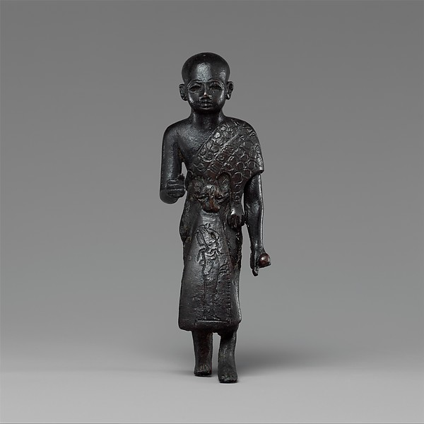 Priest in a leopard skin cloak with an inscription and Osiris on his skirt, Leaded bronze