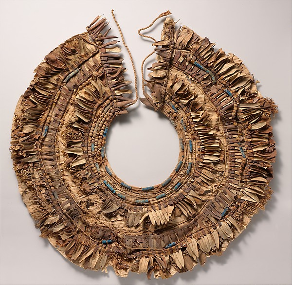 Floral collar from Tutankhamun's Embalming Cache, Papyrus, olive leaves, persea leaves, nightshade berries, celery (?), faience, linen dyed red