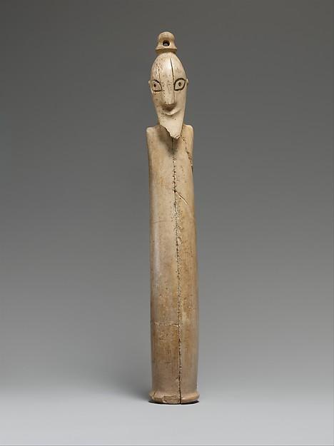 A Tusk Figurine of a Man, Ivory (hippopotamus), organic material