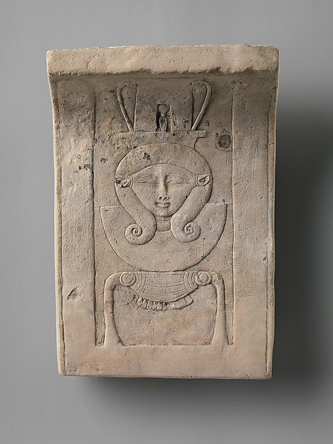 Relief plaque of Hathor emblem, curved as if from a temple frieze, Limestone