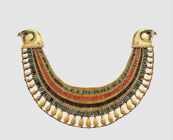 Broad collar of Senebtisi, Faience, gold, carnelian, turquoise. Falcon heads and leaf pendants originally gilded plaster, restored in gilded silver. Eyes originally gilded beads restored in gilded plaster.