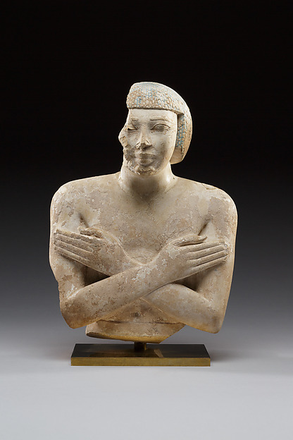 Upper part of a statue of Iqer, Limestone with traces of color