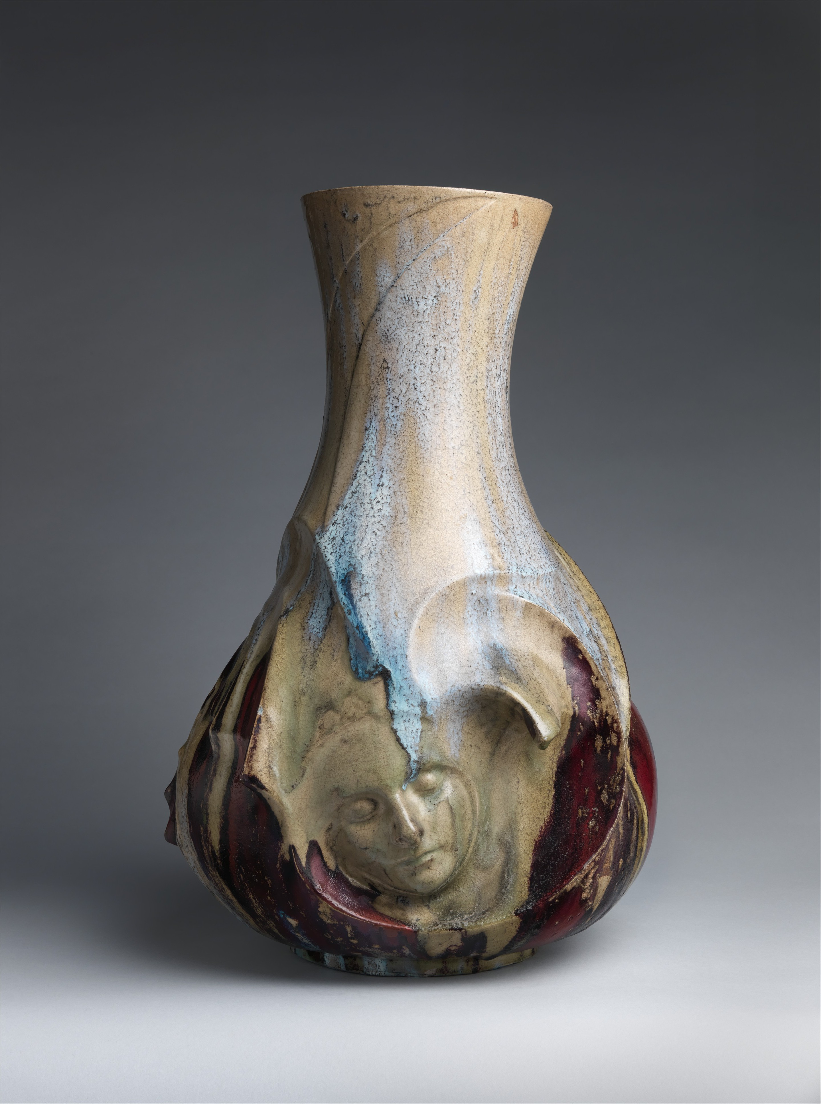 Pierre-Adrien Dalpayrat and Alphonse Voisin-Delacroix.  Vase with face, 1892–93.  Stoneware, 25 1/2 × 16 7/8 × 16 in. Object Location/Image Source:  The Metropolitan Museum of Art.
