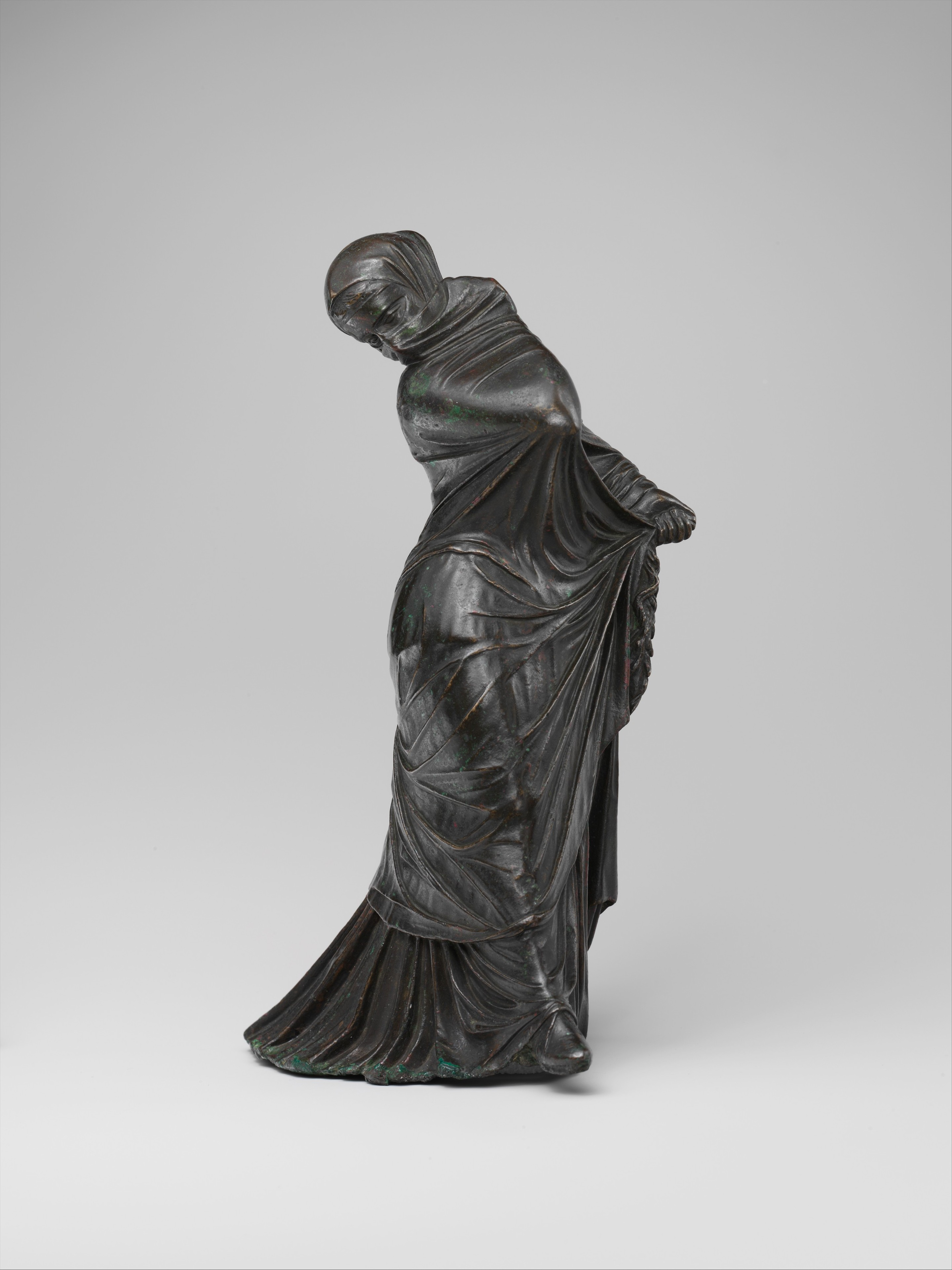 Bronze statuette of a veiled and masked dancer. Greek, 3rd