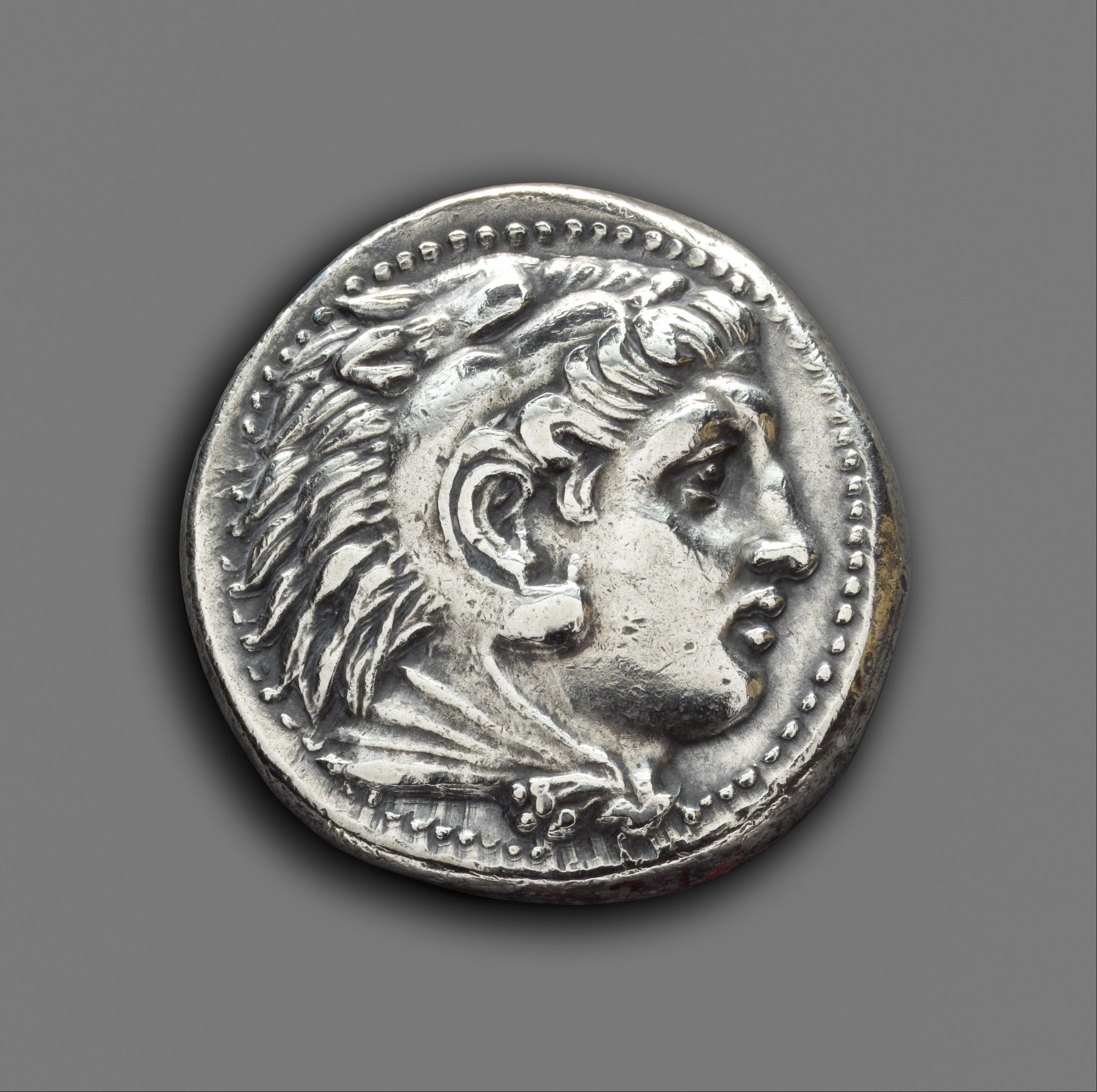عملة إغريقية - التعاملات المالية في جزيرة العرب