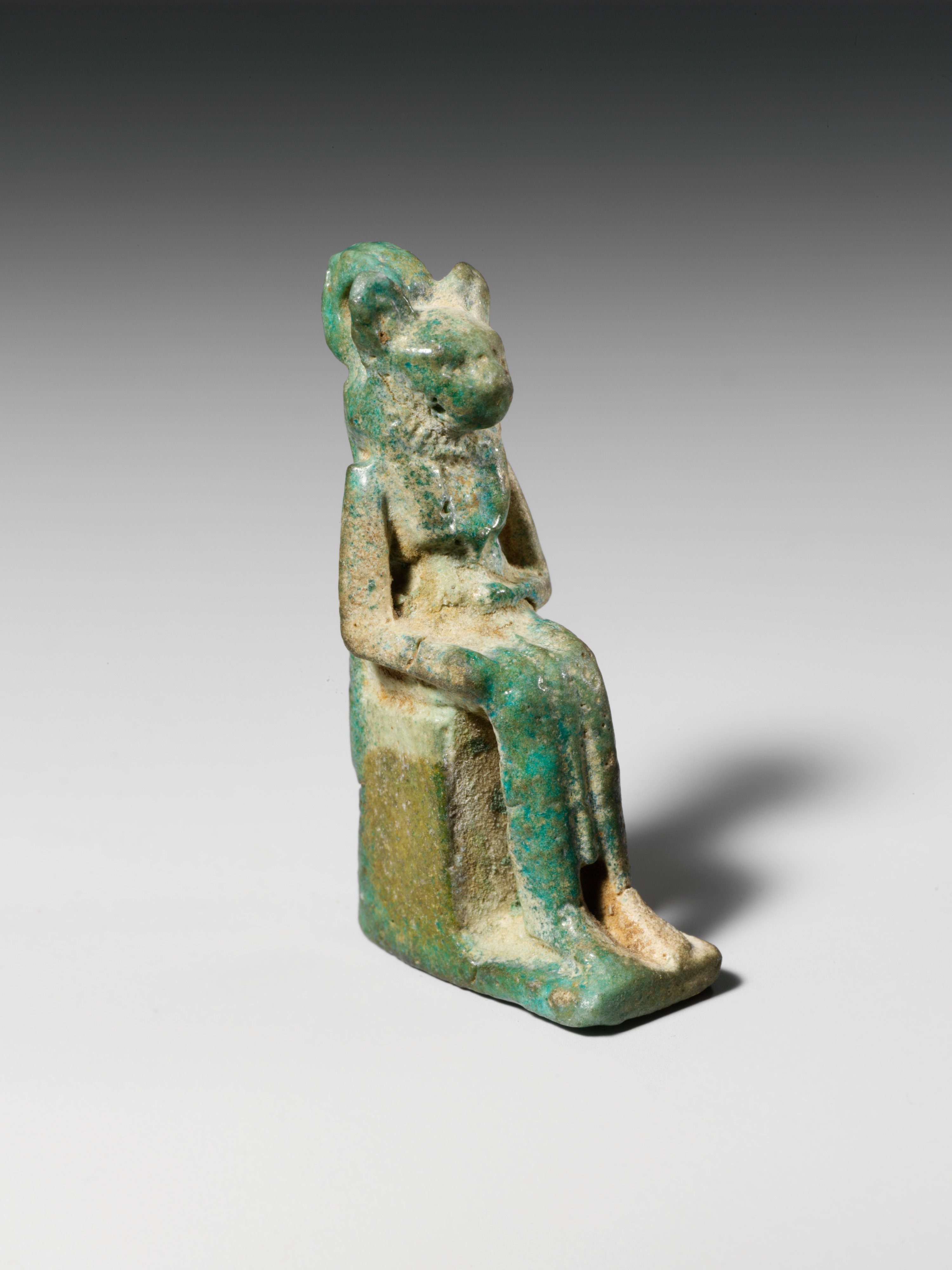 Faience amulet in the form of a lion-headed deity.