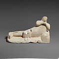 Limestone group of a male banqueter and a woman, Limestone, Cypriot