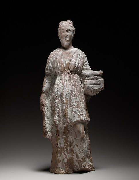 Terracotta figurine of a standing female votary holding a casket, Terracotta, Cypriot