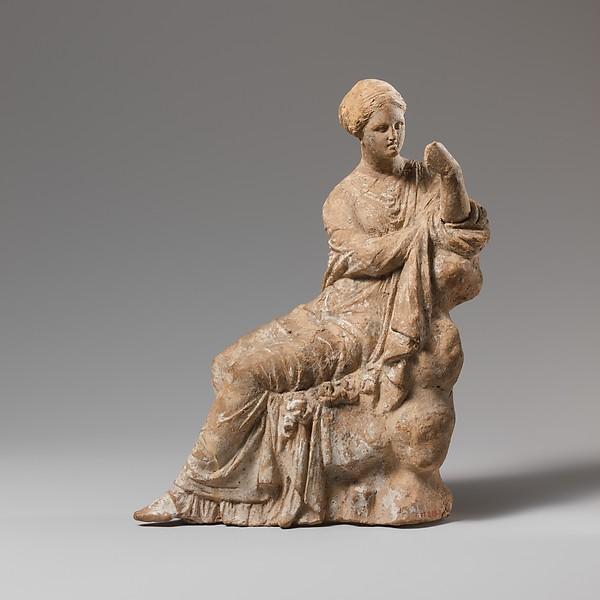 Terracotta statuette of a woman seated on a rock, Terracotta, Greek, South Italian