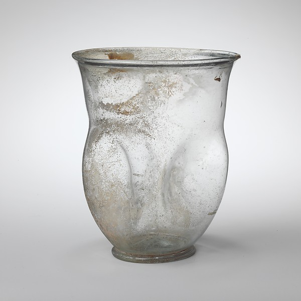 Glass beaker with indented sides, Glass, Roman