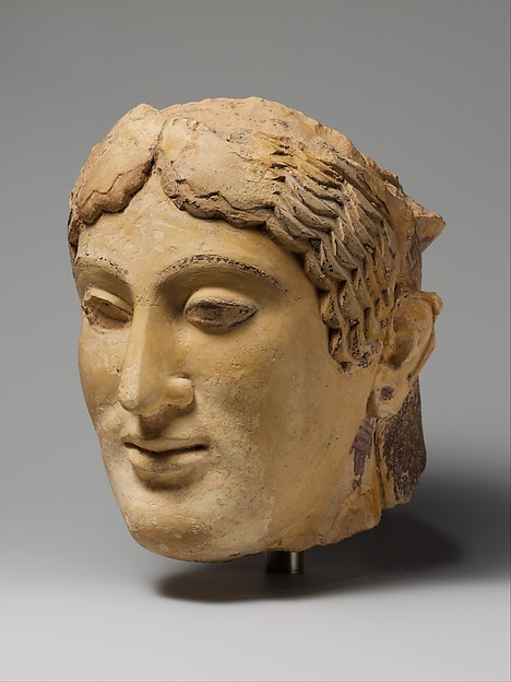 Terracotta head of a woman, probably a sphinx, Terracotta, Greek