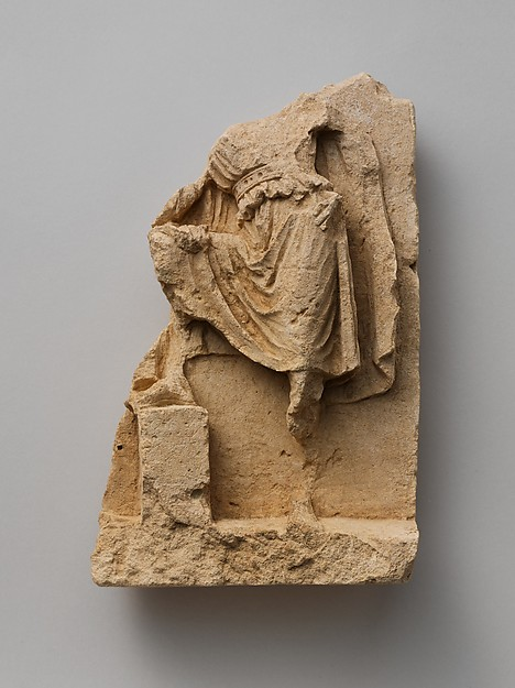 Fragment of a limestone relief with standing figure, Limestone, Greek, South Italian, Tarentine