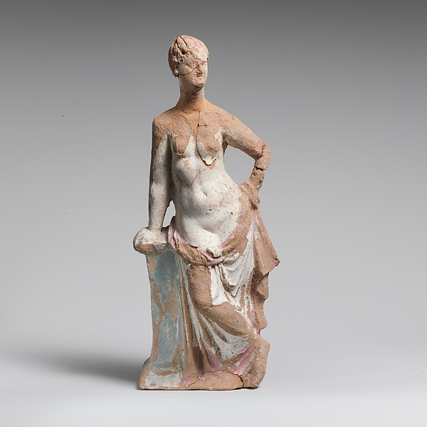 Terracotta statuette of a woman leaning on a pillar, Terracotta, Greek, South Italian, Tarentine