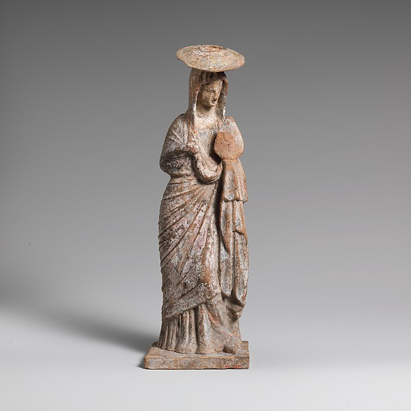 Terracotta statuette of a woman wearing a hat and holding a fan, Terracotta, Greek, Boeotian