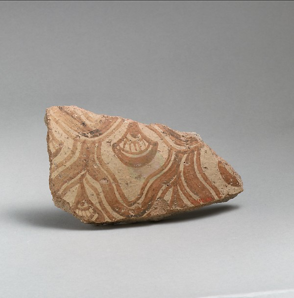 Two terracotta fragments of a large jar with reticulated pattern enclosing conventional flowers, Terracotta, Minoan