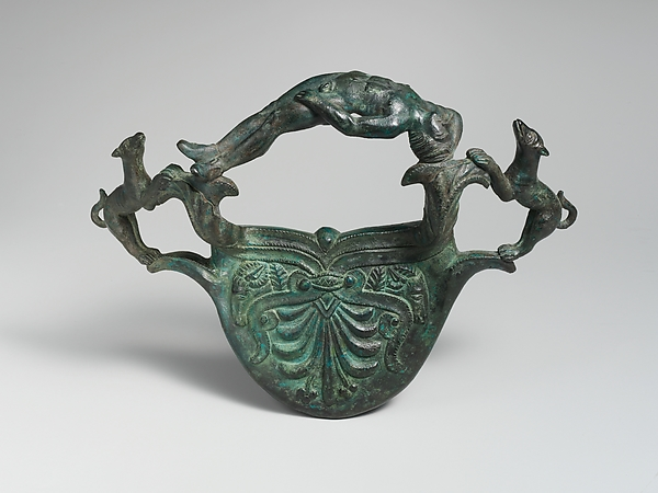 Bronze handle with dogs flanking a reclining youth, Bronze, Etruscan