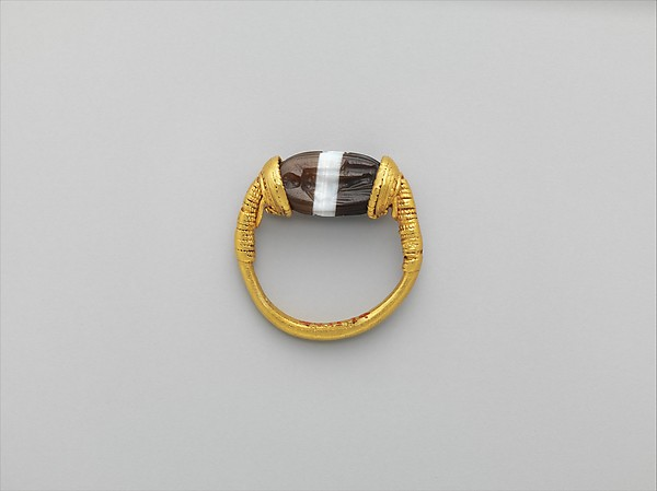 Gold and banded carnelian ring: on scarab bezel, a youth, Gold, agate, Etruscan