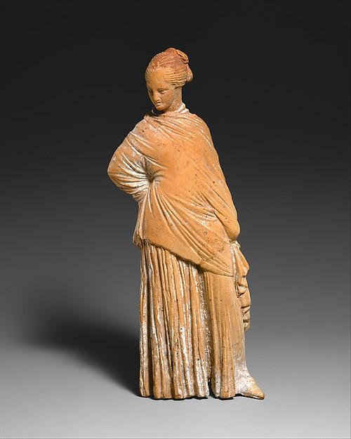 Terracotta statuette of a standing woman, Terracotta, Greek, probably Boeotian