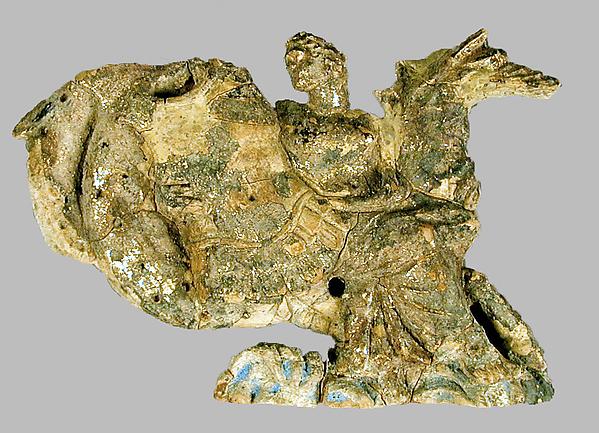 Terracotta relief of a nereid carrying a cuirass, Terracotta, Greek, South Italian, Tarentine