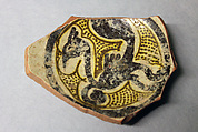 Fragment of a Bowl, Earthenware; white slip, yellow glaze, purplish black and green decoration