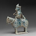 Mounted Hunter with Cheetah, Stonepaste; molded in sections, glazed in transparent turquoise, underglaze- painted in black