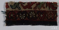Fragment, Cotton (warp and weft); wool (pile); asymmetrically knotted pile