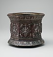 Mortar and pestle made for Abu Bakr 'Ali Malikzad al-Tabrizi, Brass; cast, chased, engraved, and inlaid with silver and black compound