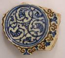 Fragment of a Bowl, Stonepaste; white slip; blue and black underglaze; transparent, colorless glaze