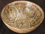 Bowl, Earthenware; buff slip, underglaze painted in polychrome pigments under a transparent glaze