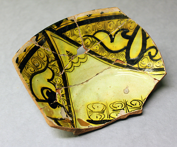 Fragment of a Bowl, Earthenware; yellow glaze over reddish body with white slip, black decoration