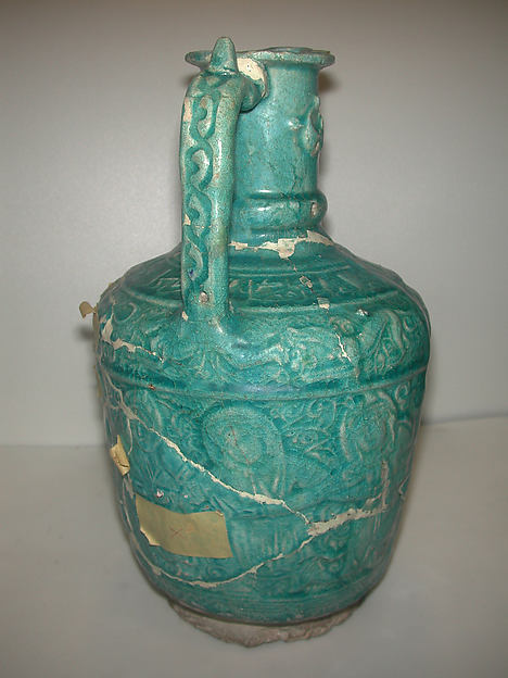 Ewer with Molded Inscriptions, Animals and Dancers, Stonepaste; molded, monochrome glazed
