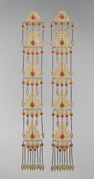 Long Temple Pendant, One of a Pair, Silver; fire-gilded, with openwork, cabochon carnelians, silver chains, and embossed pendants.