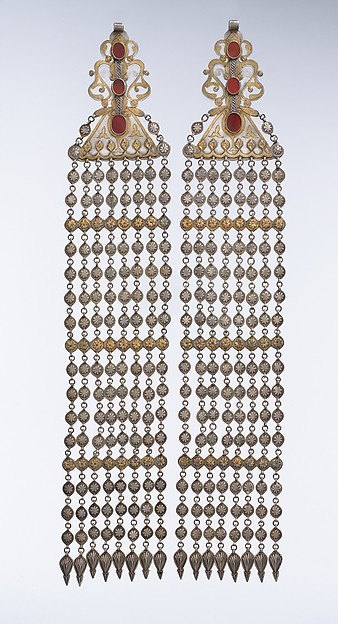 Long Temple Pendant, Silver; fire-gilded and chased, with decorative wire, applied and openwork decoration, connecting links with applied decoration, embossed pendants, and table-cut carnelians