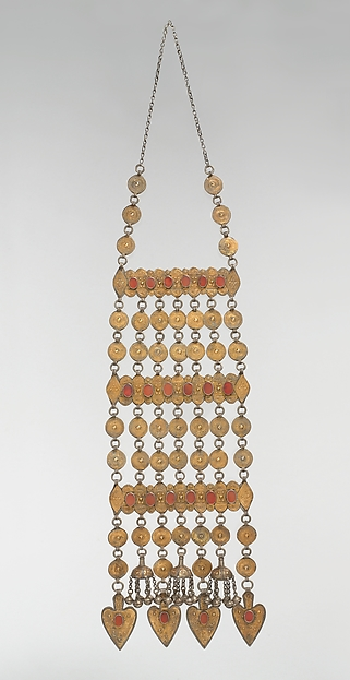 Dorsal Plait Ornament, Silver; fire-gilded with stamped and applique decoration, table cut carnelians, Persian silver coins, loop-in-loop chains, and semi-spherical bells