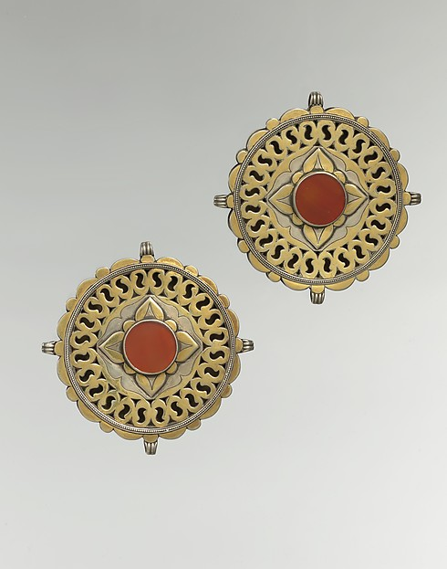 Pectoral Disc Ornament, One of a Pair, Silver; fire-gilded with stamped bead and twisted wired decoration, engraving/punching and openwork decoration and table cut carnelian